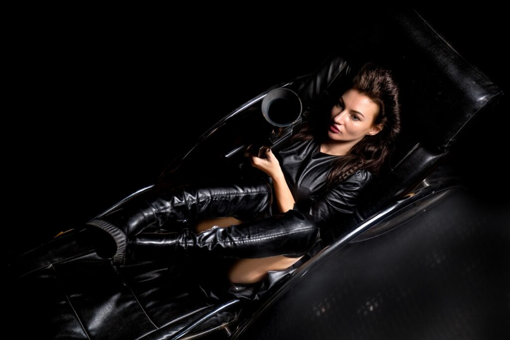 Woman in leather laying on a sofa